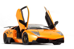 A bright orange car on a white sheet of paper looks amazing