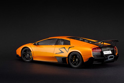 Bright cars like this orange metallic one are perfect on a black paper background